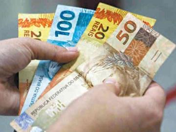 Governo reduz a projeção do salário mínimo para 2018